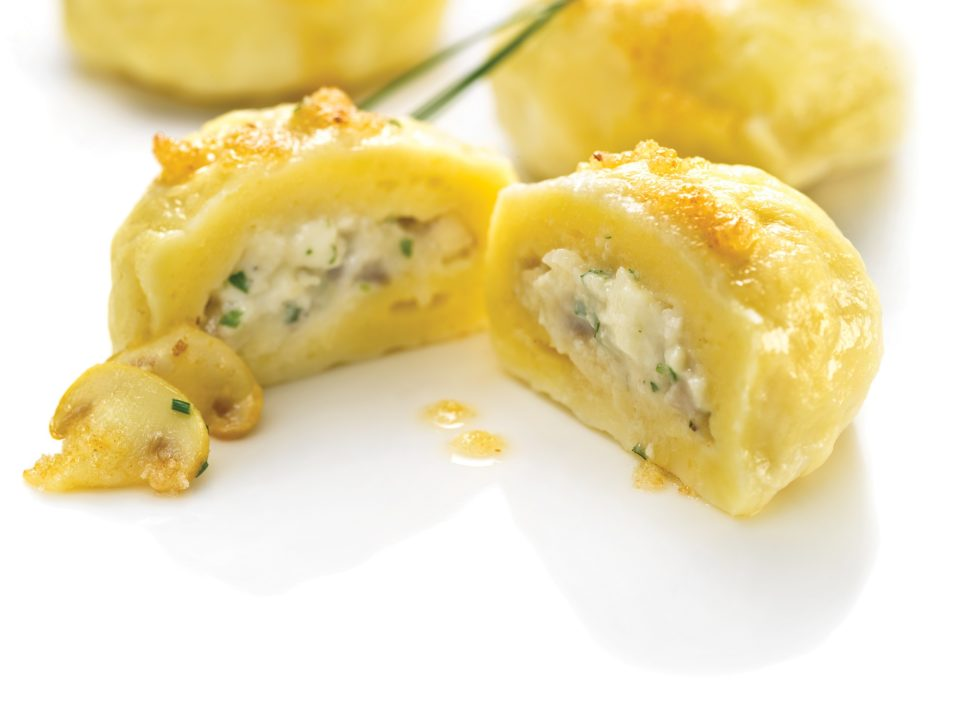 Salty cottage cheese dumplings filled with mushrooms and cheese