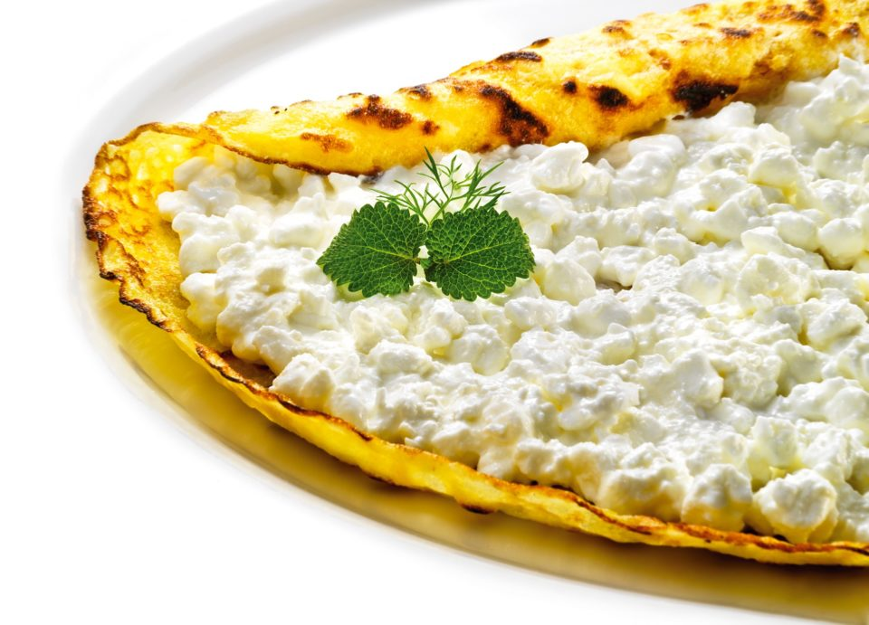 Grated salty cottage cheese pancakes